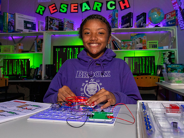 Girl working on a circuit project